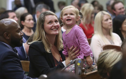 Assemblymember Buffy Wicks holds her daughter in the California Assembly Gallery during the legislative session